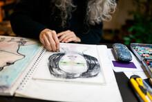 Artist Hand Drawing A Portrait
