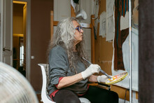 Artist Woman Painting A Male Portrait