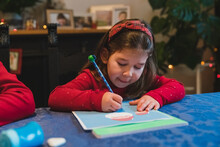 Little Girl Writing Letter To Santa Claus