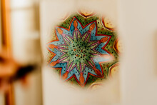 Mandala Detail Reflected In A Magnifying Glass