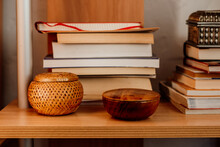 Interior Detail Of Books And Wicker And Wood Boxes