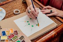 Senior Woman Painting Mandalas With Watercolors