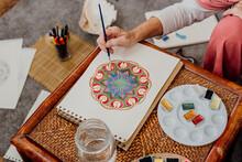 Senior Woman Painting Mandalas