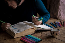 Woman Colouring In Her Sketchbook