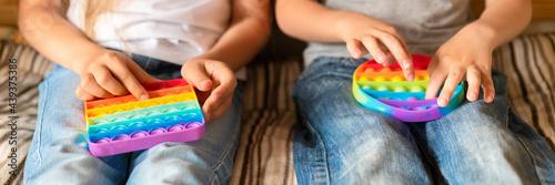 Fotografie, Obraz anti stress sensory pop it toys in a children's hands