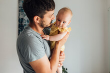 Sweet Baby Enjoying In Hugs From Caring Dad