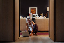 Active Mature Woman Using Laptop Before Distance Yoga Lesson