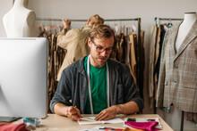 A Man Designing Clothes