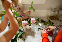 Mother And Daughter Cut Peonie Blooms For Vase