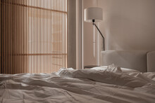 Interior Of Illuminated Modern Bedroom With Light Walls