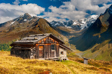 Panoramic Mountain Range With Wooden Hut