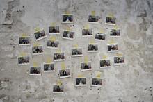 Polaroid Photos Of People On Wall