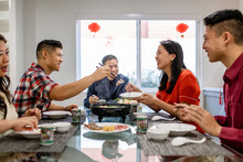 Family Celebrates Chinese New Year At The Table