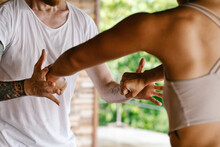 Closeup Of Teacher Helping Student In Postural Alignment Class