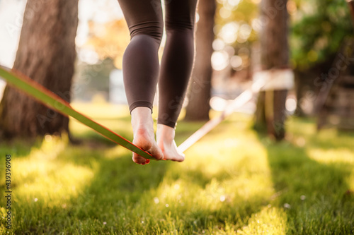 Vászonkép Slacklining is a practice in balance that typically uses nylon or polyester webbing