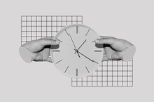 Male Hands Holding A Clock