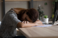 Close Up Exhausted Woman Sleeping At Work Desk, Sleepy Young Female Resting On Hands At Workplace, Tired Lazy Businesswoman Or Student Feeling Drowsy And Unmotivated, Boring Job, Lack Of Sleep