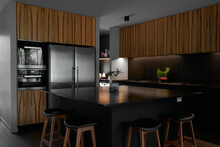 Kitchen With Large Island Bench In Black Marble