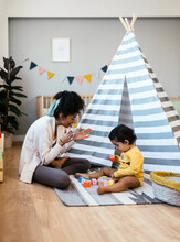 Indian Mother Encouraging Baby To Play With Cubes