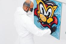 Street Artist Working In Studio On Graffiti Illustration.
