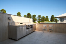 Large Outdoor Barbeque Area Of Modern Home