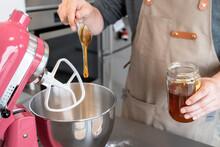 Man Adding Honey In A Mixer