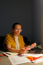 Middle Aged Woman Paying Taxes Online