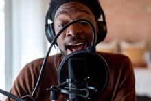 Black Blogger Singing At Home