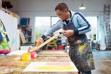 Silkscreen Artist At Work
