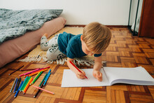 Preschooler Making Drawings With Markers