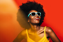 Beautiful Afro Woman Posing Over Yellow Background With Blue Sunglasses
