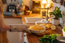 Female With Potholder Cooking Pie