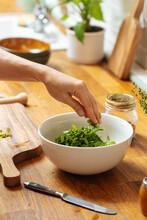 Woman Making Fresh Green Salad