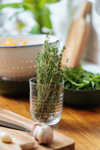 Glass With Bunch Of Fresh Thyme For Cooking