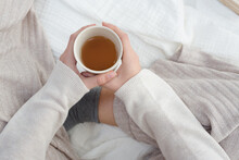 A Woman's Hand Holding Warm Cup Of Tea