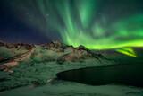 Northern lights over Norwegian fjord
