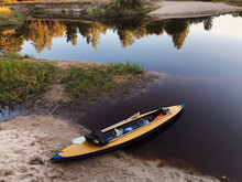 Yellow Kayak On A River Shore