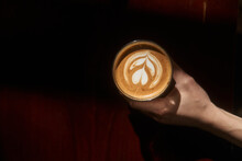 Crop Person Showing Cup Of Fresh Latte