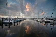 Bright Suummer Cloudscape Reflected In Tranquil Water Of Dinner Key Marina In Coconut Grove, Miami, Florida.