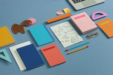 Overview Of Document, Gadget, Cup Of Coffee, Crumpled Papers, And Business Supplies On Workplace