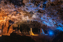 Speleologists Admiring Rocky Calcite Cave