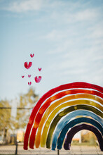 Hand Painted Rainbow With Hearts On A Window