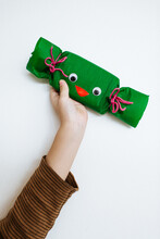 Toddler Hand Holding A Gift With Googly Eyes