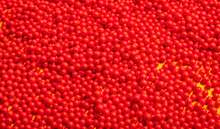Bunch Of Red Round Shapes-Balls On Yellow Background.