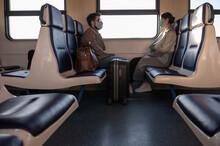 Man And Woman Sitting Near Window In Train