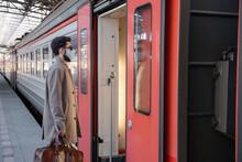 Man In Mask Entering Train Door
