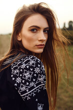 Close Up Fashion Portrait Of Young Beautiful Woman Dressed In Navy Blue Embroidered Shirt.