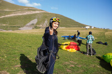 Happy Woman With Camera Ready To Paraglide