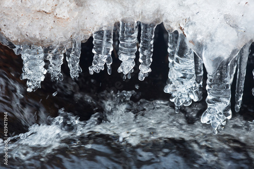 Fototapeta Winter icicles formed over Railroad Brook in Vernon, Connecticut.