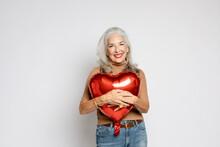 Woman Hugs Heart Ballon